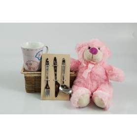 Children's basket. Mug, cutlery and teddy bear