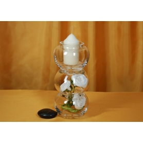 Glass candle holder with dried flowers decoration